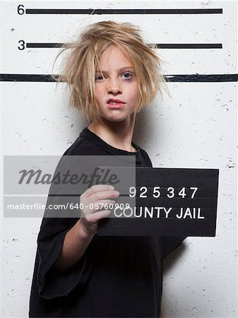 Studio mugshot of girl (8-9) with tousled hair Stock Photo - Premium Royalty-Free, Image code: 640-05760909