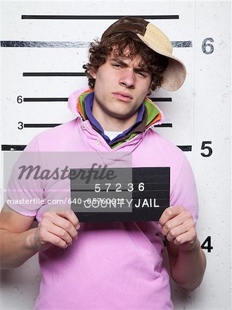 Mug shot of young man in baseball cap Stock Photo - Premium Royalty-Free, Image code: 640-05760911