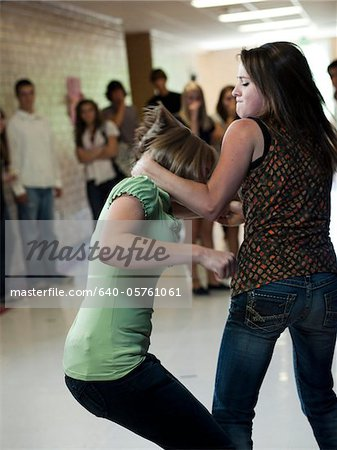 USA, Utah, Spanish Fork, Two girls (14-17) fighting in school corridor Stock Photo - Premium Royalty-Free, Image code: 640-05761061
