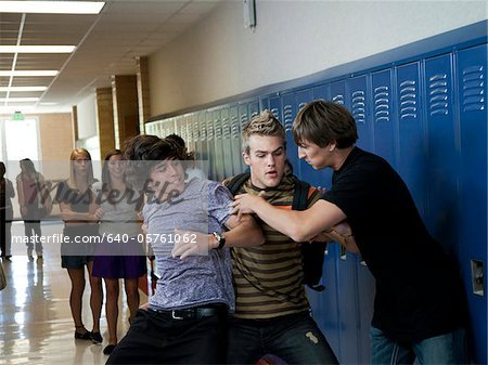 USA, Utah, Spanish Fork, Three boys (16-17) fighting in school corridor Stock Photo - Premium Royalty-Free, Image code: 640-05761062