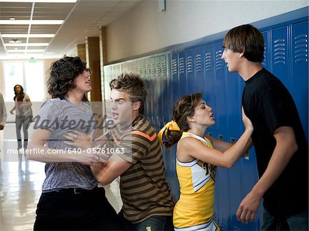 USA, Utah, Spanish Fork, Four school children (16-17) fighting in school corridor Stock Photo - Premium Royalty-Free, Image code: 640-05761063