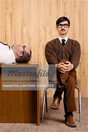 Bored businessmen resting in office Stock Photo - Premium Royalty-Free, Image code: 640-05761203