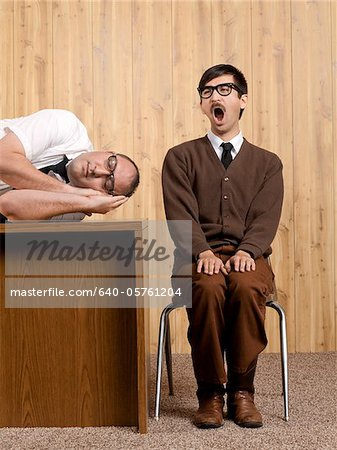 Bored businessmen resting in office Stock Photo - Premium Royalty-Free, Image code: 640-05761204