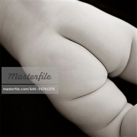 Baby's bottom, studio shot Stock Photo - Premium Royalty-Free, Image code: 640-05761375