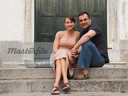 Italy, Ravello, Couple sitting on stairs Stock Photo - Premium Royalty-Free, Image code: 640-06050017