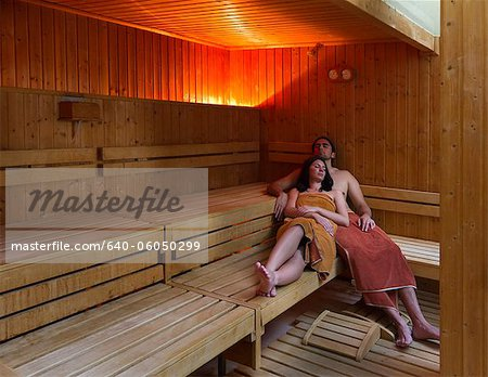 Italy, Tuscany, Young couple relaxing in sauna Stock Photo - Premium Royalty-Free, Image code: 640-06050299