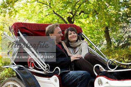 USA, New York City, Manhattan, Central Park, Mature couple in carriage in Central Park Stock Photo - Premium Royalty-Free, Image code: 640-06050697
