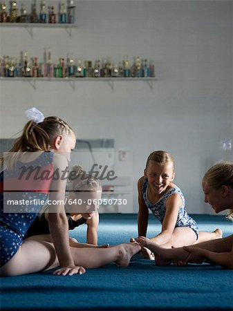USA, Utah, Orem, girls (8-11) exercising in gym Stock Photo - Premium Royalty-Free, Image code: 640-06050730