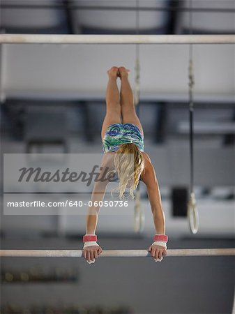 USA, Utah, Orem, girl (10-11) exercising on pole in gym Stock Photo - Premium Royalty-Free, Image code: 640-06050736