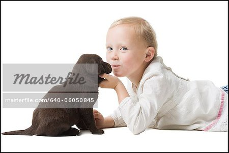 child with puppy Stock Photo - Premium Royalty-Free, Image code: 640-06050845