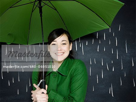 woman in a chalkboard rainstorm Stock Photo - Premium Royalty-Free, Image code: 640-06051010
