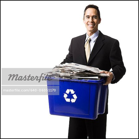 businessperson holding a recycling bin Stock Photo - Premium Royalty-Free, Image code: 640-06051170