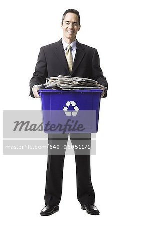 businessperson holding a recycling bin Stock Photo - Premium Royalty-Free, Image code: 640-06051171