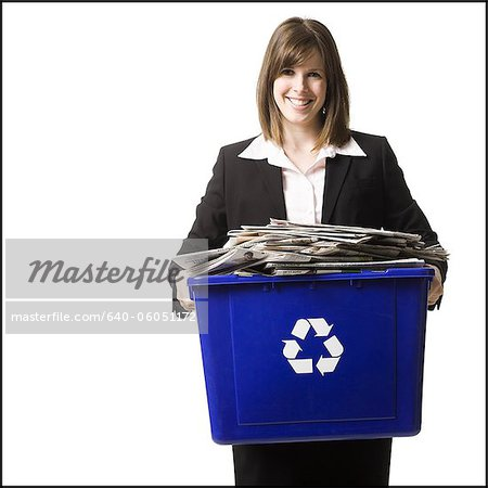 businessperson holding a recycling bin Stock Photo - Premium Royalty-Free, Image code: 640-06051172