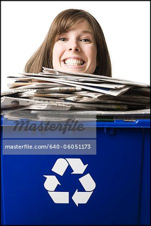 businessperson holding a recycling bin Stock Photo - Premium Royalty-Free, Image code: 640-06051173