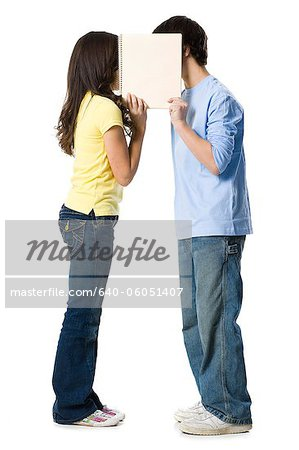 young couple holding a sign Stock Photo - Premium Royalty-Free, Image code: 640-06051407
