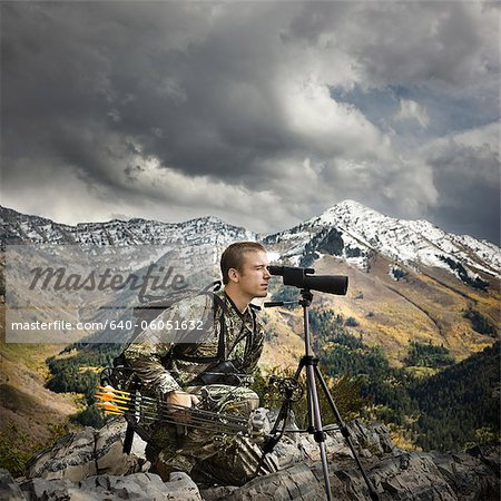 hunter using binoculars to spot prey Stock Photo - Premium Royalty-Free, Image code: 640-06051632
