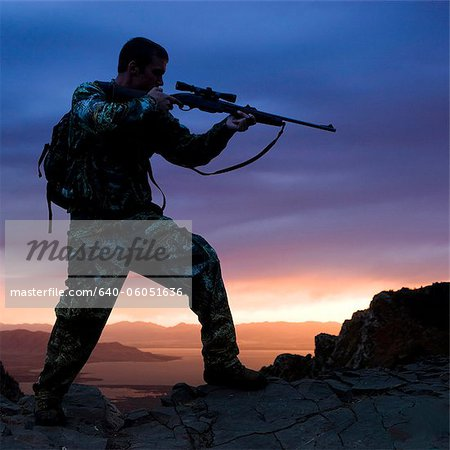 hunter against a sunset Stock Photo - Premium Royalty-Free, Image code: 640-06051636