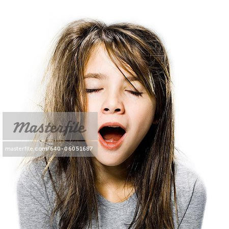 girl waking up in the morning Stock Photo - Premium Royalty-Free, Image code: 640-06051687