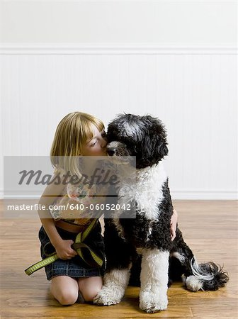 girl and her dog Stock Photo - Premium Royalty-Free, Image code: 640-06052042