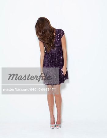 Young woman wearing dress Stock Photo - Premium Royalty-Free, Image code: 640-06963474