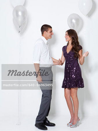 Young couple flirting at party Stock Photo - Premium Royalty-Free, Image code: 640-06963495