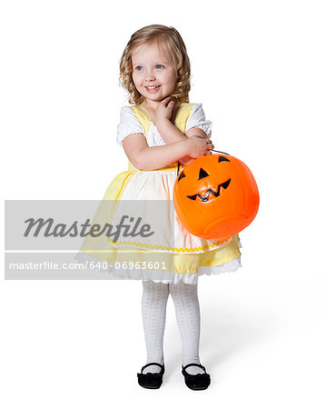Girl (2-3) in Goldilocks costume with pumpkin lantern for Halloween Stock Photo - Premium Royalty-Free, Image code: 640-06963601