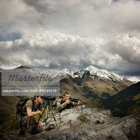 hunter using binoculars to spot prey Stock Photo - Premium Royalty-Free, Image code: 640-08089178