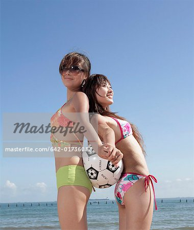 Two young women with volleyball on beach Stock Photo - Premium Royalty-Free, Image code: 642-01736053