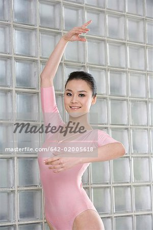 a female artistic gymnast Stock Photo - Premium Royalty-Free, Image code: 642-02005618