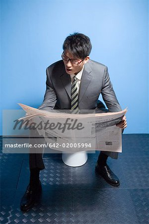 a reading busines man Stock Photo - Premium Royalty-Free, Image code: 642-02005994
