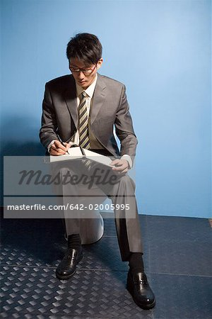 a reading busines man Stock Photo - Premium Royalty-Free, Image code: 642-02005995