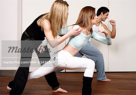 Students learning a basic Capoeira move Stock Photo - Premium Royalty-Free, Image code: 644-01436947
