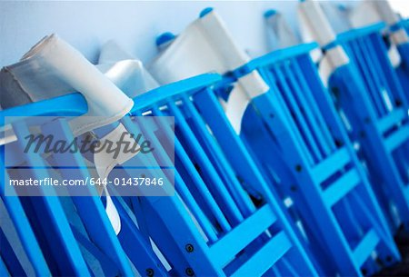 Row of folded chairs Stock Photo - Premium Royalty-Free, Image code: 644-01437846