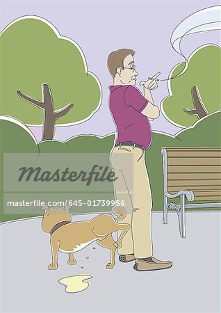 Man waiting for dog to urinate in the park Stock Photo - Premium Royalty-Free, Image code: 645-01739956