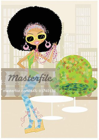 Funky woman in an afro on a terrace Stock Photo - Premium Royalty-Free, Image code: 645-01740133
