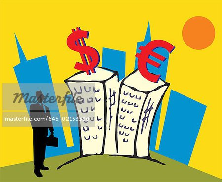 Businessman standing by buildings and looking at currency symbols Stock Photo - Premium Royalty-Free, Image code: 645-02153390