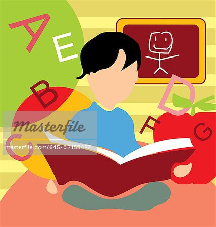 Front view of a boy studying book Stock Photo - Premium Royalty-Free, Image code: 645-02153427