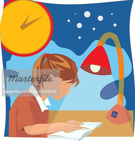 Side view of a girl studying book Stock Photo - Premium Royalty-Free, Image code: 645-02153430