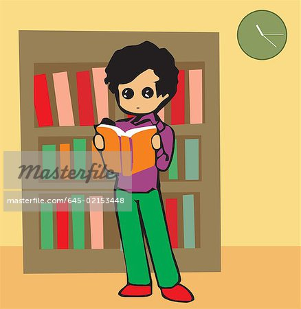Front view of a boy reading book Stock Photo - Premium Royalty-Free, Image code: 645-02153448