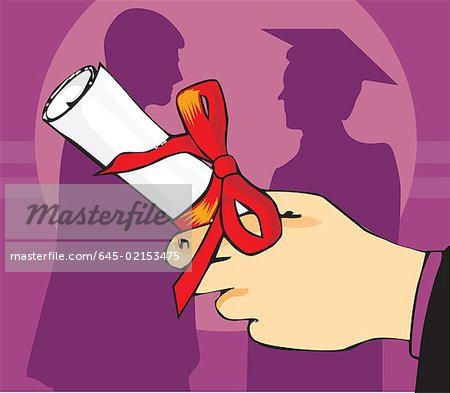 Close up view of a hand holding graduation degree Stock Photo - Premium Royalty-Free, Image code: 645-02153475