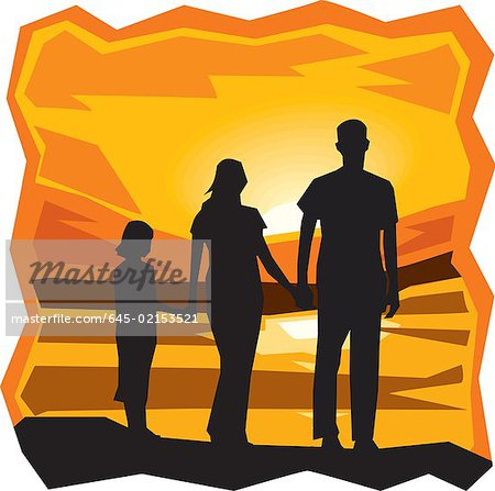 Rear view of family standing by the sea at sunset Stock Photo - Premium Royalty-Free, Image code: 645-02153521