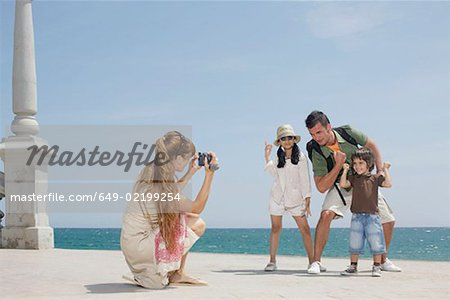 Mother taking video of family by sea Stock Photo - Premium Royalty-Free, Image code: 649-02199254