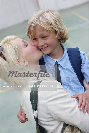 Mother kissing school boy Stock Photo - Premium Royalty-Free, Image code: 649-02199359