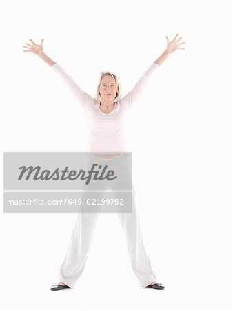 Mature woman stretching Stock Photo - Premium Royalty-Free, Image code: 649-02199752