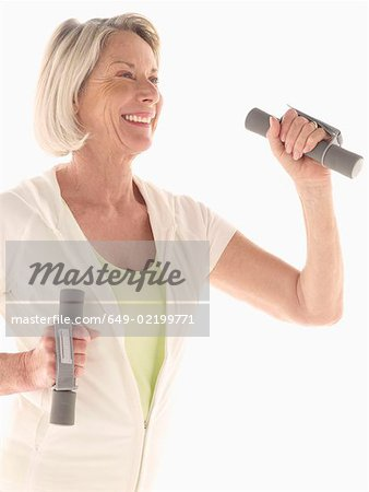 Mature woman with hand weights Stock Photo - Premium Royalty-Free, Image code: 649-02199771