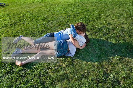 Teen couple laying on grass, kissing Stock Photo - Premium Royalty-Free, Image code: 649-02290325