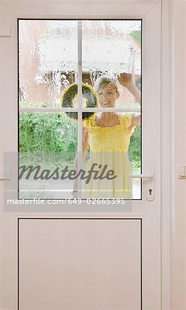 Young girl knocking on a door Stock Photo - Premium Royalty-Free, Image code: 649-02665395