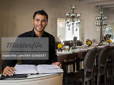 Portrait of a male host to a restaurant Stock Photo - Premium Royalty-Free, Image code: 649-02665437