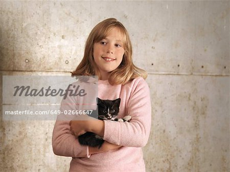 Girl Holding Kitten Stock Photo - Premium Royalty-Free, Image code: 649-02666647